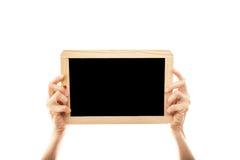 拿着黑板的女性手 库存照片
