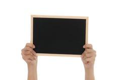 拿着黑板的妇女手 免版税库存图片