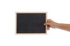 拿着黑板的妇女手 免版税库存照片