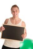 拿着黑板的年轻人适合的人 库存照片