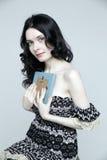 拿着画框的美丽的妇女 免版税图库摄影