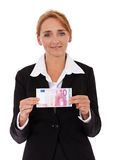 拿着10欧元的女实业家 库存照片