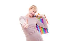 拿着购物妇女的袋子 图库摄影