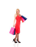 拿着购物微笑的妇女的袋子 免版税图库摄影