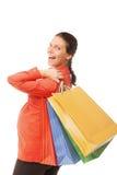 拿着购物袋的孕妇被隔绝 免版税图库摄影