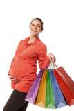 拿着购物袋的孕妇被隔绝 图库摄影