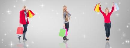 拿着购物袋的愉快的金发碧眼的女人的综合图象 免版税库存图片