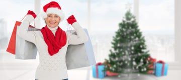 拿着购物袋的欢乐的妇女的综合图象 免版税库存照片