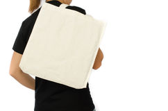 拿着购物袋的年轻俏丽的女孩 季节性假日想法拉紧 免版税库存照片