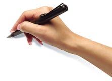 拿着黑笔的手 免版税库存照片