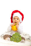 拿着黄色胡椒的小厨师 库存图片