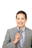 拿着年轻人的有吸引力的生意人玻璃 免版税库存图片