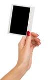 拿着Polarid照片的妇女的手 库存图片