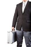 拿着stong金属手提箱的年轻商人隔绝了白色b 免版税库存照片