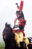 拿破仑式的战争战士- reenactor骑马 库存照片