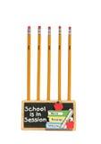 持有人铅笔学校 免版税库存照片
