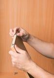 挂接木家具的木匠 库存图片