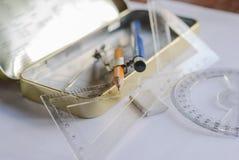 指南针、铅笔和统治者在方格纸 库存照片