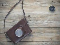 指南针和影片照相机 免版税库存照片