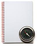 指南针和笔记本 免版税库存照片