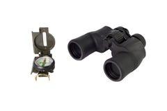 指南针和黑双筒望远镜 免版税图库摄影