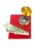 指南针概念货币护照飞机旅行 免版税库存图片