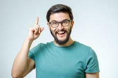 指向一个好主意的激动的人 免版税库存图片