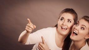 指向与一个手指的愉快的妇女 库存图片