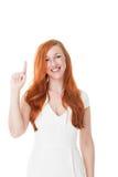 指向与她的手指的美丽的妇女 库存照片