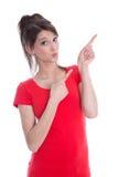 指向与手指的美丽的年轻女商人。 库存照片