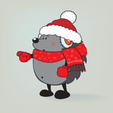 指向与手指的逗人喜爱的看的圣诞节猬 库存照片