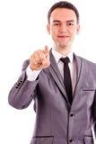 指向与他的手指的一个年轻商人的画象 免版税库存照片
