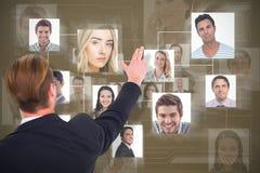 指向与他的手指的商人背面图的综合图象 免版税库存图片
