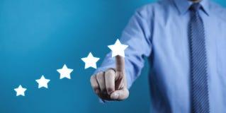 指向五星的商人增量规定值 的评估 库存照片