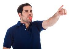 指向体育运动的教练吹口哨 免版税库存图片