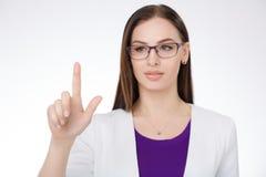 指向反对白色背景的女实业家 免版税库存图片