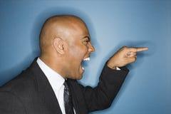 指向叫喊的生意人 免版税库存照片