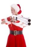 指向圣诞老人微笑的枪辅助工 免版税库存照片