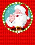 指向圣诞老人的克劳斯 库存照片