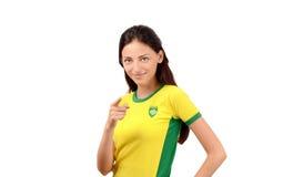 指向在前面的美丽的巴西女孩 免版税库存照片