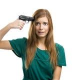 指向在她自己的一杆枪 库存图片