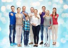 指向在您的小组微笑的人民手指 免版税库存照片