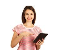 指向在片剂计算机上的一名快乐的行家妇女的画象手指 在白色背景隔绝的情感女孩 免版税库存图片