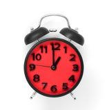 指向在白色的1:00的红色时钟表盘 免版税库存图片