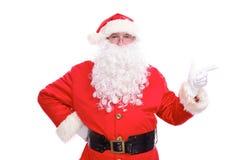 指向在白色空白的标志的亲切的圣诞老人,隔绝在白色背景 图库摄影