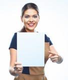 指向在白色空白的横幅的女商人手指 免版税图库摄影