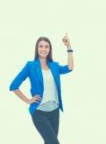指向在白色背景的年轻女商人画象  免版税图库摄影