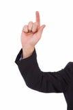 指向在衣服夹克的Businessmans手 库存图片