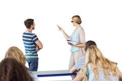指向在类的黑板的学生和老师的综合图象 免版税库存照片