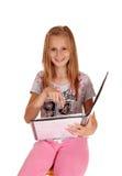 指向她的书的女小学生 库存图片